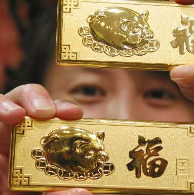 Giá vàng tiếp tục trượt xuống 1.373USD/ounce